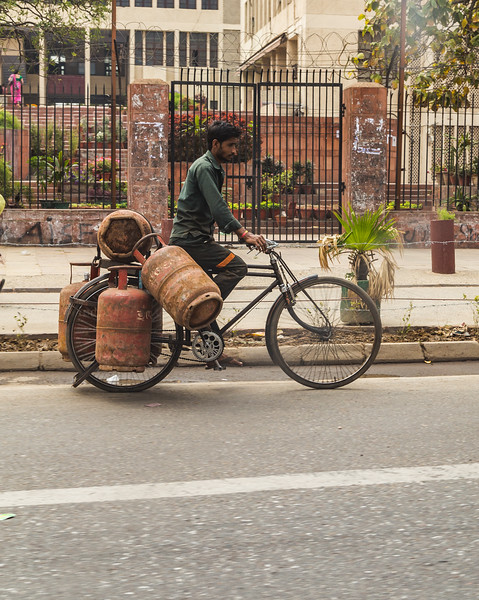Man Transporting Gas Canisters in Delhi
