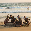 Group of Men playing on the beach in Varkala, India