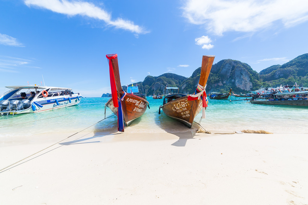 Long-tail boats, the Andaman Sea and hills in Ko Phi Phi Don, Thailand