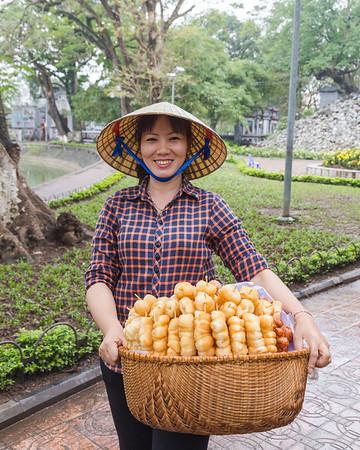 Lady selling sweet treats in Hanoi Vietnam