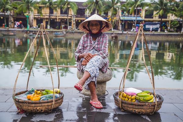 Elderly lady selling fruit in Hoi An
