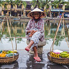 Elderly lady selling fruit in Hoi An