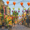 Colourful architecture and lanterns along streets of Hoi An Ancient Town during the day