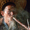 Smoke Break<br /> Li River<br /> Yangshou, Guangxi, China<br /> <br /> Traditionally, Chinese fishermen use a long wooden pipe with a brass holder to smoke. You can see the ashes resting precariously on the cigarette during his smoke break.