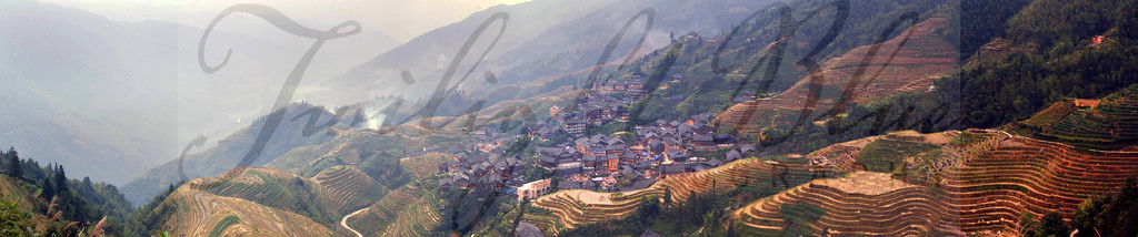 Terraced Rice Paddies<br /> Overlook 1 View over Ping'an Village<br /> Ping'an Village, Guangxi, China<br /> <br /> The panorama from Overlook One captures a 180 degree view of the terraces and village below. The terraced rice paddies are a modern marvel created by a society which was forced to make due with the land where they were given. The Zhuang Minority was pushed from the lowlands into the mountains over 600 hundred years ago. Here generations carved terraces of rice paddies into the mountains surrounding their village and are still working the land today.