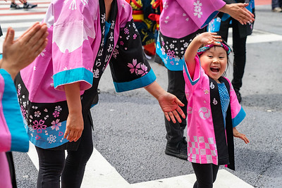 Excited young girl at festival in Tokyo's Shibuya ward.