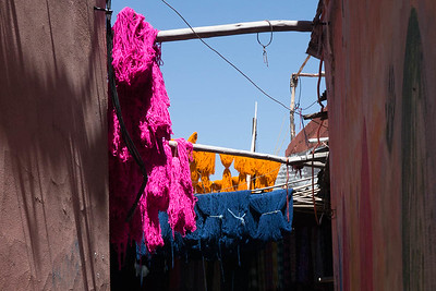 Freshly dyed wool hanging to dry