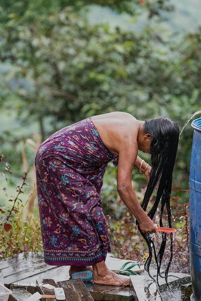 Village woman bathing - Kampalet