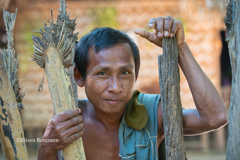 Man posing at his front gate in Ohn Ne village - Mandalay