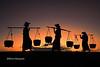 Women with baskets at sunset - Bagan - Batan