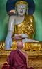 Budha and monk at Shwedagon Pagoda, Yangon