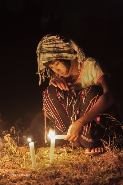 Girl with ceremonial candles at Min An Thu Village, Bagan