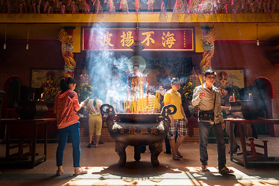 Practitioners like incense at the Chia On Lang temple in Ho Chi Minh City