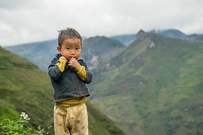 A young Hmong boy poses for the camera near the China-Vietnam border.