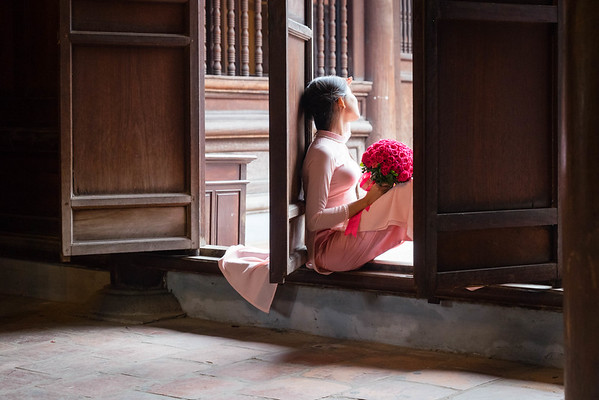 A girl poses for her university graduation photo at the Temple of Literature in Hanoi.