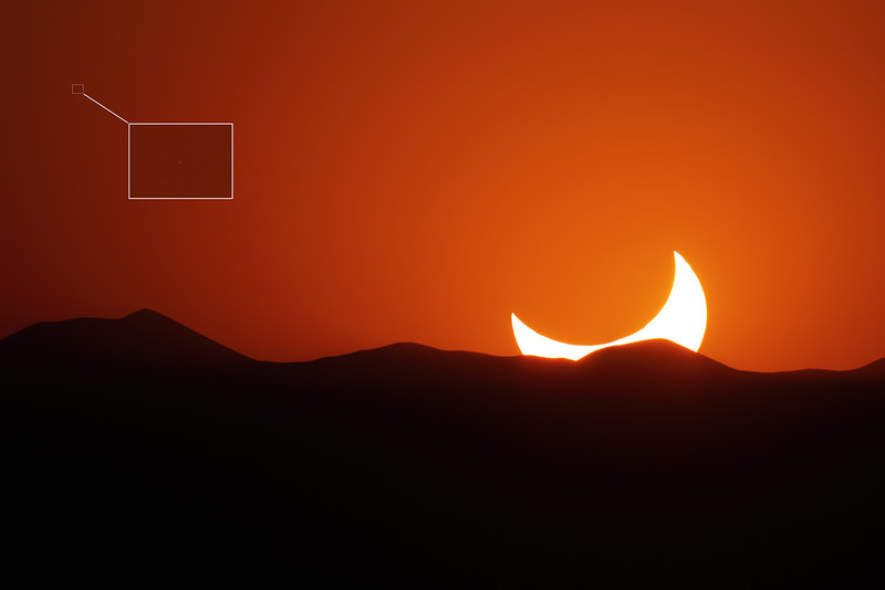 "May 20, 2012 - Annular eclipse from El Paso, Texas. <br /> Unknown object in the darkening sky.  These appear in somewhat random locations in many of the eclipse images.  There were no bright stars in the area, and the nearby planets had already set.  <br /> <br /> Mouse-over image and click ""original"" for a 100% view.<br /> <br /> Field of view is 1.6 x 2.4 degrees at 1.67 arc-sec/pixel<br /> <br /> Camera: Canon 7D<br /> Lens: Takahashi FSQ-106ED<br /> Tripod: Quickset HD video tripod<br /> Exposure: ISO 100, f5 @ 1/5000 second<br /> <br /> Location: El Paso, Texas"
