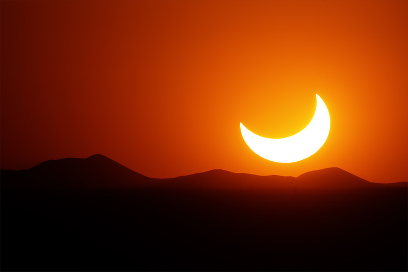 May 20, 2012 - Annular eclipse from El Paso, Texas.  About 20 minutes after peak obscuration, the Sun set (still heavily obscured).  <br /> <br /> Camera: Canon 7D<br /> Lens: Takahashi FSQ-106ED<br /> Tripod: Quickset HD video tripod<br /> Exposure: ISO 100, f5 @ 1/8000 second<br /> <br /> Location: El Paso, Texas