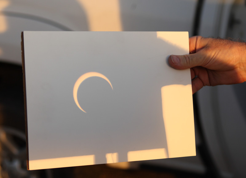 May 20, 2012 - Annular eclipse from El Paso, Texas. <br /> Binocular Projection at peak obscuration, at 17:39 MDT<br /> <br /> Camera: Canon 30D<br /> Lens: EF 24-70 f2.8L<br /> Tripod: N/A<br /> Exposure: ISO 100, f2.8 @ 1/50 second<br /> <br /> Location: El Paso, Texas<br /> <br /> Photographed by Dano