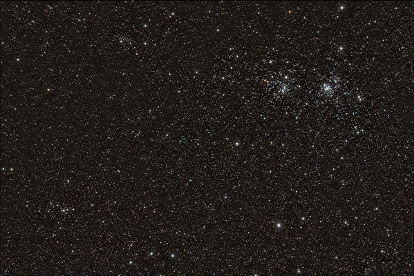 Widefield view of the Double Cluster (Caldwell 14)  ~1.5 hours of LRGB L=10x300s R=10x60 G=10x60 B=10x60 Calibration 20,20,10 flats of each LRGB  Date: 11/22/11  Telescope: Takahashi FSQ-106ED with CAA Mount: Astro-Physics Mach1GTO Guider: Meade DSI Pro through Astrodon MMOAG, with 2 Px Dither CCD: Finger Lakes Instruments ML11002 CCD, with 65mm shutter Fiter Wheel: Finger Lakes Instruments CFW-2-7 Filters: Baader 50.8mm LRGB  Software: MaximDL, Registar, Photoshop CS3 with Carboni & GXT Location: Light polluted back yard in El Paso, Texas  Polar Alignment: PoleAlignMax
