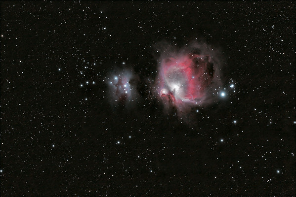 M42 - The Orion Nebula + NGC1977 - The Running Man Nebula This was among the first of my successful deep sky images  Date: 1/08/2010  This is a combination of 3 night of data, at different exposures. Exposure: 65 x 90 seconds                  40 x 15 seconds  Calibration 20,20,20 (Dark, Flat, Bias)  Telescope: Stellarvue SV80ST Mount: G11  Guider: Meade DSI Pro through 300mm Lens - Custom mount Camera: Canon 30D - unmodified + Televue TRF-2008 Flattener/Reducer Fiter Wheel: N/A Filters: Astronomik CLS Clip-in  Software: Deep Sky Stacker, Photoshop CS3 with Carboni & GXT Location: Light polluted back yard in El Paso, Texas  Polar Alignment: Losmandy Polar Scope  Published on Stellarvue.com - Shot of the Week, 1/23/2010