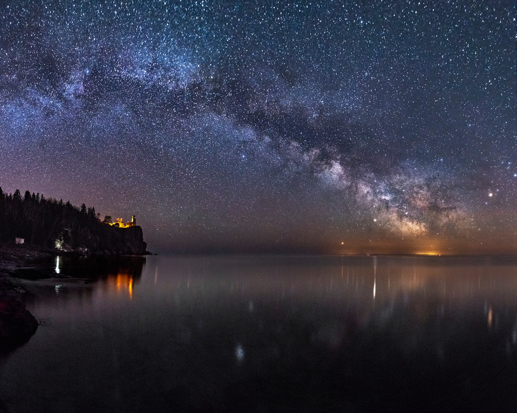 The Milky Way arches over Lake Superior and Split Rock Lighthouse.