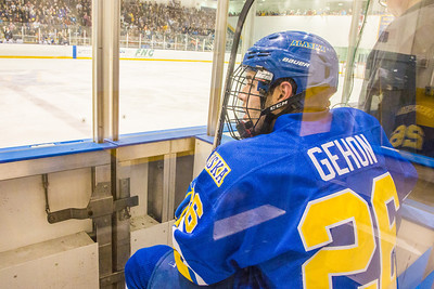 Senior Chad Gehon gets to think about his game during a stint in the penalty box during the Blue vs. Gold match in the Patty Ice rink.  Filename: ATH-12-3570-168.jpg
