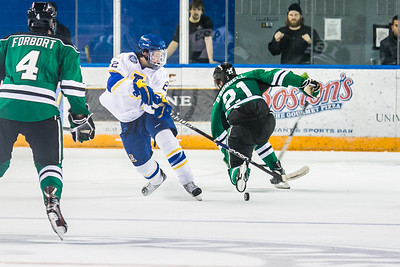 Freshman Josh Atkinson takes the puck away from an opponent during the Nanooks' 2-1 win over North Dakota in the Carlson Center.  Filename: ATH-12-3601-87.jpg