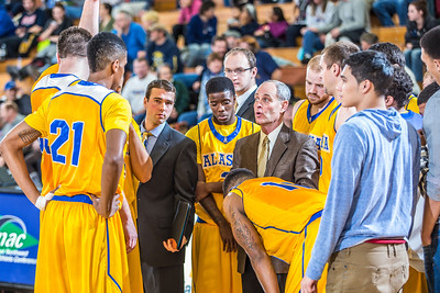 Head coach Mick Durham huddles with his team during the Nanooks' 83-72 win over Fresno Pacific in the championship game of the GCI Alaska Invitational tournament.  Filename: ATH-13-4005-93.jpg