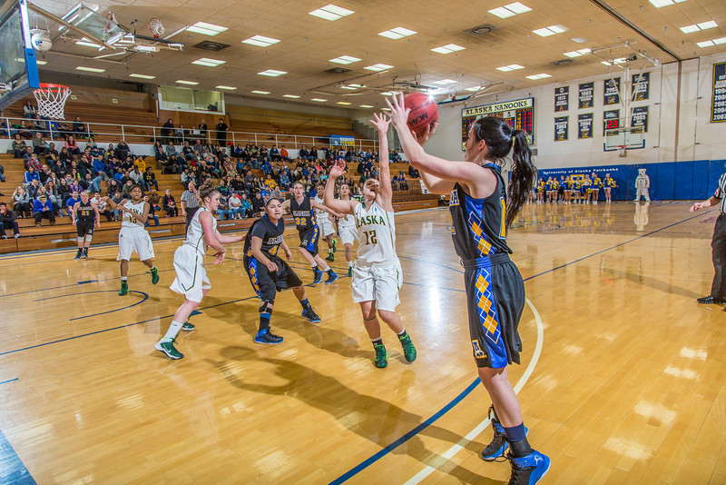 """Junior Kelly Logue shoots a three-pointer during the second half of the Nanooks game against the rival Seawolves from UAA Jan. 18 in the Patty Gym.  <div class=""""ss-paypal-button"""">Filename: ATH-14-4041-2.jpg</div><div class=""""ss-paypal-button-end"""" style=""""""""></div>"""