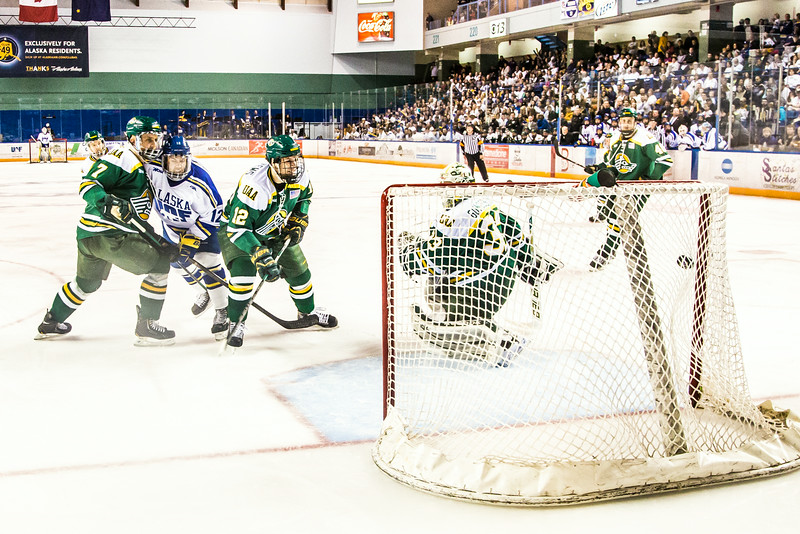 """Wing Garrick Perry, #12, watches as a shot hits the back of the net during the Nanooks game against the UAA Seawolves for the 2014 Governor's Cup March 8 in the Carlson Center.  <div class=""""ss-paypal-button"""">Filename: ATH-14-4109-181.jpg</div><div class=""""ss-paypal-button-end""""></div>"""