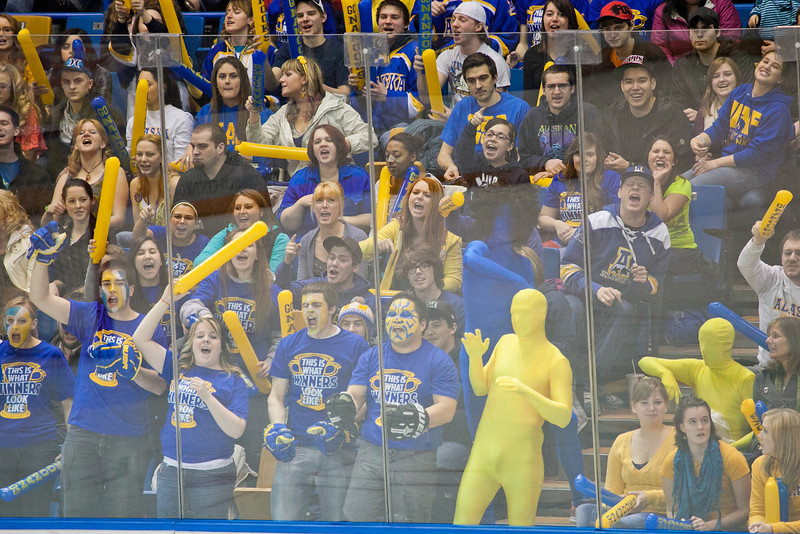 """Fans in the student section of the Carlson Center react to a penalty called on the opponents during the Nanooks' battle against the UAA Seawolves for the coveted Governor's Cup trophy.  <div class=""""ss-paypal-button"""">Filename: ATH-12-3304-032.jpg</div><div class=""""ss-paypal-button-end"""" style=""""""""></div>"""