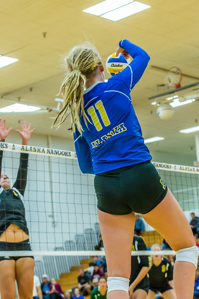 """Action from the Nanooks match in the 2013 Nanook Classic tournament in the Patty Center.  <div class=""""ss-paypal-button"""">Filename: ATH-13-3930-188.jpg</div><div class=""""ss-paypal-button-end""""></div>"""