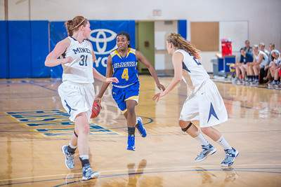 Sophomore Benissa Bulaya pushes the ball up the court during second half action in the Nanooks' game against the Colorado School of Mines in the Patty Center.  Filename: ATH-12-3639-85.jpg