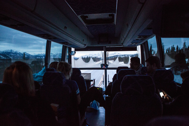 "A chartered bus carrying a UAF contingent drives on the scenic Parks Highway en route to Anchorage to support the men's' hockey team for the Governor's Cup match.  <div class=""ss-paypal-button"">Filename: ATH-13-4017-39.jpg</div><div class=""ss-paypal-button-end"" style=""""></div>"