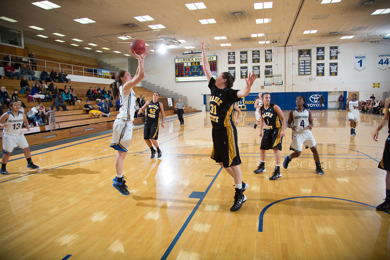 "Freshman forward Kaillee Skjold shoots a 15-foot jumper during the second half of the championship game of the North Star Invitational Tournament against Wayne State in the Patty Gym.  <div class=""ss-paypal-button"">Filename: ATH-13-4010-135.jpg</div><div class=""ss-paypal-button-end"" style=""""></div>"