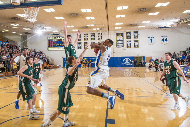 "With the score tied and 1.9 seconds remaining, Ronnie Baker somehow managed to get a pass off to teammate Andrew Kelly who turned and banked in a shot at the buzzer to lead the Nanooks to a thrilling come-from-behind victory over the Seawolves from UAA Feb. 27 in the Patty Gym.  <div class=""ss-paypal-button"">Filename: ATH-14-4097-41.jpg</div><div class=""ss-paypal-button-end"" style=""""></div>"