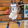"""Point guard Benissa Bulaya looks for an opening in the defense during a game against Montana State Billings.  <div class=""""ss-paypal-button"""">Filename: ATH-13-3720-68.jpg</div><div class=""""ss-paypal-button-end"""" style=""""""""></div>"""