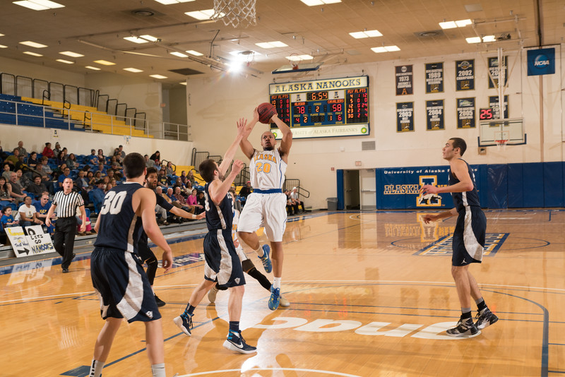 """Senior guard Joe Slocum gets inside for two points during the Nanooks' 92-69 win over Concordia University Feb. 20 in the Patty Gym.  <div class=""""ss-paypal-button"""">Filename: ATH-16-4810-73.jpg</div><div class=""""ss-paypal-button-end""""></div>"""