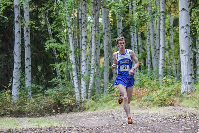 Freshman runner John Klein pushes forward Thursday, August 30, 2012 at the 8kmen's race with Seattle Pacific and Black Hills State University. Klein finished 19th overall with a time of  28:44.2 minutes.  Filename: ATH-12-3530-66.jpg