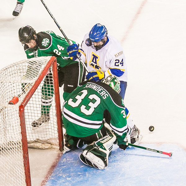 "Freshman Nolan Huysmans just missed scoring on this play during the championship game of the 2012 Brice Alaska Goal Rush tournament in the Carlson Center. The Nanooks went on to beat second-ranked North Dakota 2-1 to claim the title. Senior goaltender Steve Thompson, who stopped 25 of 26 shots during the final game, was named tournament MVP.  <div class=""ss-paypal-button"">Filename: ATH-12-3601-171.jpg</div><div class=""ss-paypal-button-end"" style=""""></div>"