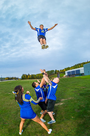 UAF cheerleaders practice in front of the SRC on the Fairbanks campus.  Filename: ATH-13-3943-101.jpg