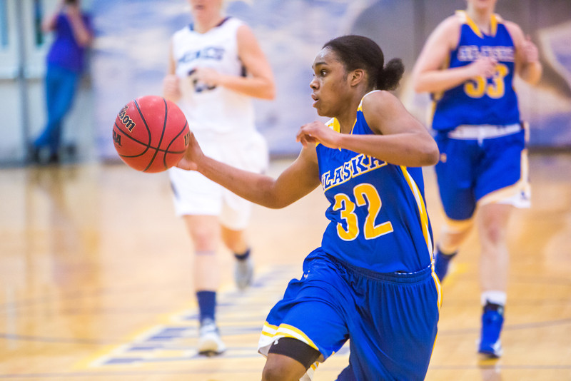 """Junior April Fultz drives toward the lane during first half action in the Nanooks' game against the Colorado School of Mines in the Patty Center.  <div class=""""ss-paypal-button"""">Filename: ATH-12-3639-51.jpg</div><div class=""""ss-paypal-button-end"""" style=""""""""></div>"""