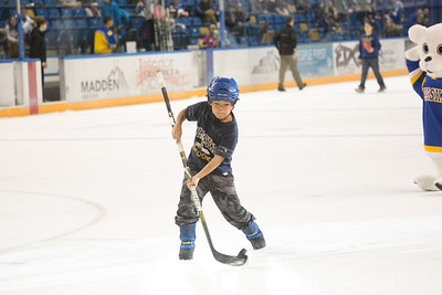 Eight-year-old Ambrose Phillips gets a chance to score with the puck between periods during the Nanooks' 2-1 win over North Dakota in the Carlson Center.  Filename: ATH-12-3601-221.jpg