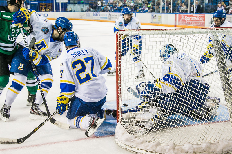 "Senior goalie Steve Thompson stops another shot on goal during the Nanooks' 2-1 win over North Dakota in the Carlson Center.  <div class=""ss-paypal-button"">Filename: ATH-12-3601-8.jpg</div><div class=""ss-paypal-button-end"" style=""""></div>"