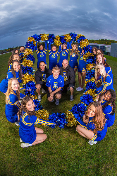 """UAF cheerleaders pose in front of the SRC on the Fairbanks campus.  <div class=""""ss-paypal-button"""">Filename: ATH-13-3943-145.jpg</div><div class=""""ss-paypal-button-end"""" style=""""""""></div>"""