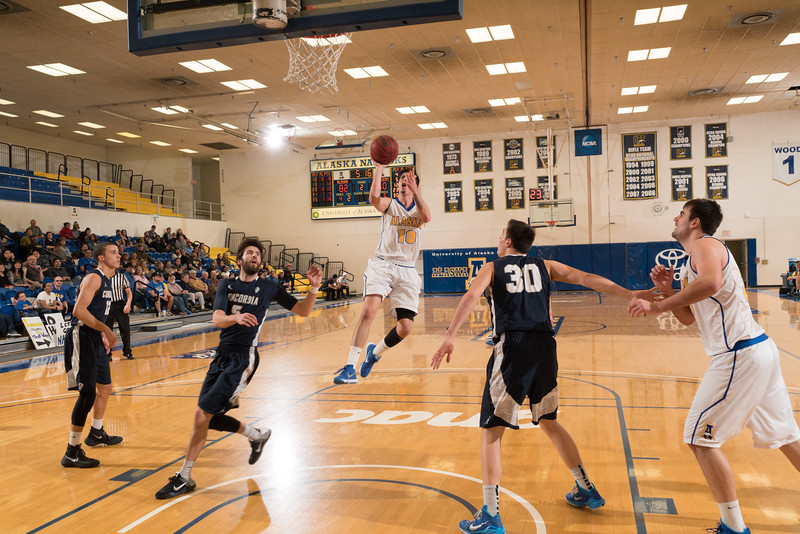 "Junior forward Neal Chavez shoots a running one-hander during the Nanooks' 92-69 win over Concordia University Feb. 20 in the Patty Gym.  <div class=""ss-paypal-button"">Filename: ATH-16-4810-76.jpg</div><div class=""ss-paypal-button-end""></div>"