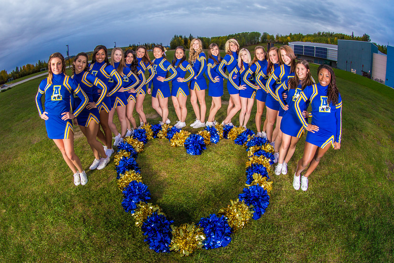 "UAF cheerleaders pose in front of the SRC on the Fairbanks campus.  <div class=""ss-paypal-button"">Filename: ATH-13-3943-140.jpg</div><div class=""ss-paypal-button-end"" style=""""></div>"