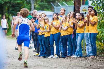 UAF cheerleaders encourage the runners during a cross country Thursday, August 30, 2012 on the UAF West Ridge ski trails.  Filename: ATH-12-3530-91.jpg