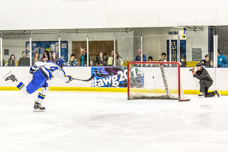 "Junior Colton Parayko tops 100 mph on his slap shot during a challenge exhibition between periods of the annual Blue-Gold intra-squad hockey game Sept. 27 in the Patty Ice Arena.  <div class=""ss-paypal-button"">Filename: ATH-14-4330-143.jpg</div><div class=""ss-paypal-button-end""></div>"