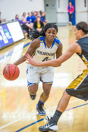Point guard Benissa Bulaya drives toward the lane during the first half of the championship game of the North Star Invitational Tournament against Wayne State in the Patty Gym.  Filename: ATH-13-4010-23.jpg
